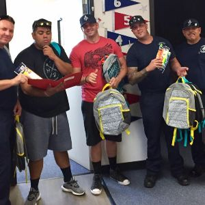 IMAGE: West Valley Firefighters with backpacks.