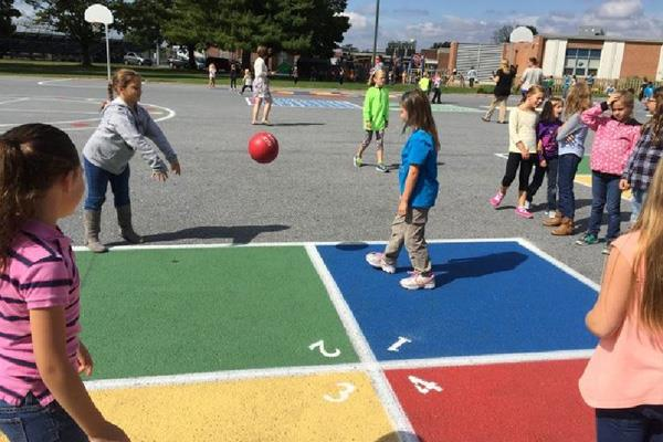 Children at Recess playing ball