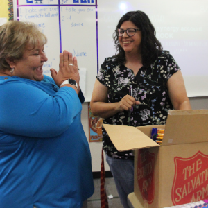 IMAGE: Ms. Holt and Principal Vroegh Open School Supplies.