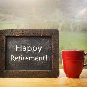 IMAGE: Happy retirement on chalkboard with coffee cup.